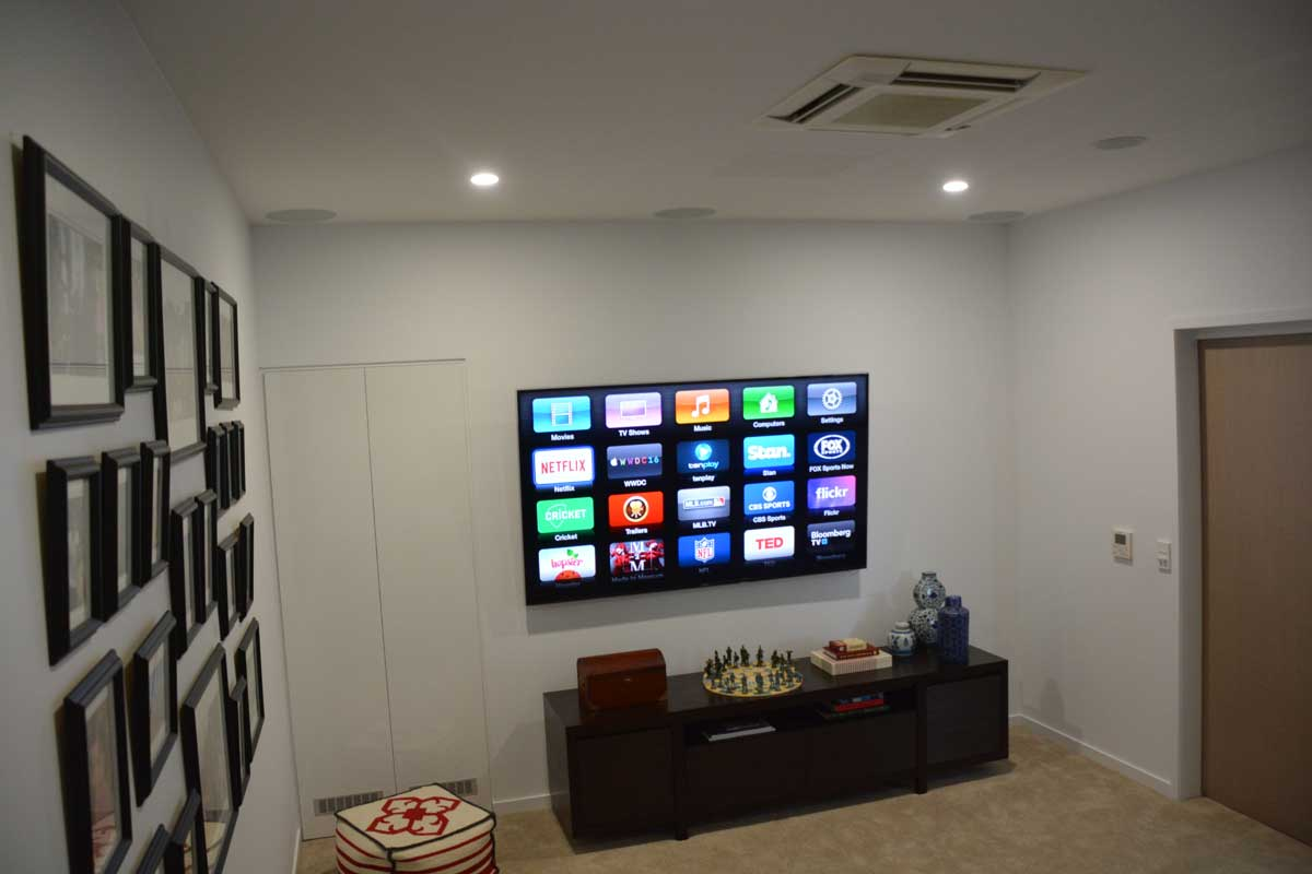 Salt Penthouse Apartment – Media Room with wall mounted TV, SpeakerCraft in-ceiling Home Theatre system.
